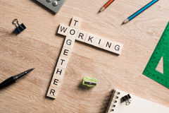 Working together words collected of game cubes on wooden surface Royalty Free Stock Photos