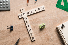 Working together words collected of game cubes on wooden surface Stock Photo