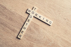Working together words collected of game cubes on wooden surface Stock Image