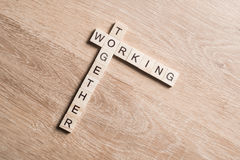 Working together words collected of game cubes on wooden surface Royalty Free Stock Images