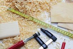 Working tool carpenter ruler, chisel, pencil, sawdust and shavings. Working tool carpenter ruler, chisel, pencil, sawdust and shavings royalty free stock photo