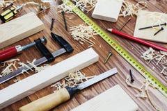 Working tool carpenter ruler, chisel, pencil, sawdust and shavings. Working tool carpenter ruler, chisel, pencil, sawdust and shavings stock images