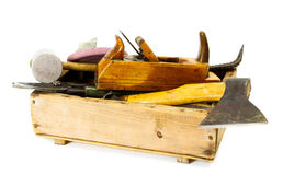 Working tools (axe, chisel, plane and others) in. Old working tools. Working tools (axe, chisel, plane and others) in an old box on white background Royalty Free Stock Photography