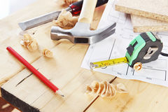 Working tools of carpenter lie on the workbench. Working tools of carpenter lie on the wooden workbench Royalty Free Stock Photos
