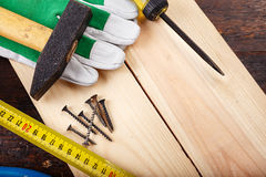 Working tools carpenter on a wooden background Stock Images