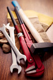 Working Tools and Gloves on a Wooden Table Royalty Free Stock Photos