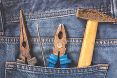 Working tools in jeans pocket. Close up Royalty Free Stock Photos