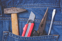 Working tools in jeans pocket. Close up Royalty Free Stock Photography