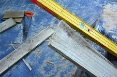 Working Tools - leveler and saw tool. Working tools,leveler and saw tool, in building site. Concept photo, background texture image with copy- space Stock Images