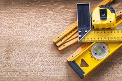 Working tools of measurement on oaken wooden board. Construction concept Stock Photo