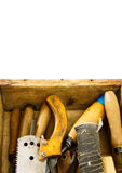 Working tools in an old box on white background. Old working tools. Working tools (mallet, saw and others) in an old box on white background Royalty Free Stock Photography