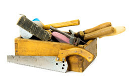 Working tools in an old box on white background. Old working tools. Working tools (mallet, saw and others) in an old box on white background Stock Photography