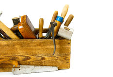 Working tools in an old box on white background. Old working tools. Working tools (mallet, saw and others) in an old box on white background Stock Photos