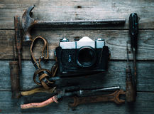 Working tools and photo camera Stock Photos