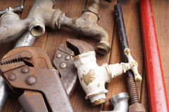 Working tools, plumbing, pipes and faucets. Plumbing tools lying with old pipes and faucets royalty free stock photo