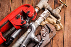 Working tools, plumbing, pipes and faucets. Plumbing tools lying with old pipes and faucets stock photos