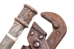 Working tools, plumbing, pipes and faucets. Plumbing tools lying with old pipes and faucets royalty free stock photos