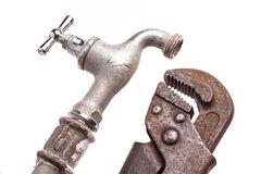 Working tools, plumbing, pipes and faucets. Plumbing tools lying with old pipes and faucets stock photo