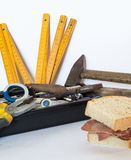 Working tools with a sandwich Royalty Free Stock Image