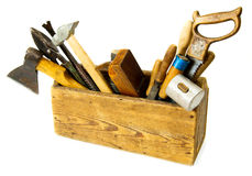Working tools (saw, axe, chisel and others) in an. Old working tools. Working tools (saw, axe, chisel and others) in an old box on white background Stock Images