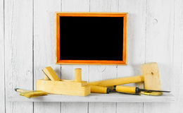 Working tools on shelf and frame Stock Photo