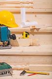 Working tools on steps of wooden ladder Royalty Free Stock Photo
