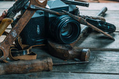 Working tools and vintage photo camera Stock Image