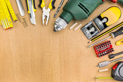 Working tools on wood background Royalty Free Stock Image