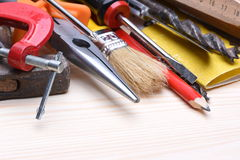 Working tools on wooden board Stock Photography