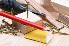 Working tools on wooden board Royalty Free Stock Image