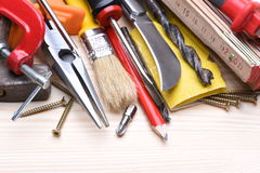 Working tools on wooden board Royalty Free Stock Photos