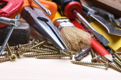 Working tools on wooden board Stock Photo