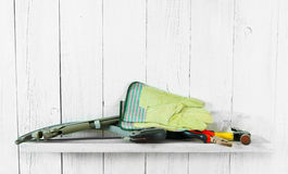 Working tools on wooden shelf Royalty Free Stock Photos