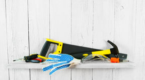 Working tools on wooden shelf Royalty Free Stock Image