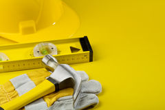Working tools on yellow background Royalty Free Stock Images