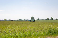 Working tractor with water tank in pasture meadow Royalty Free Stock Photos