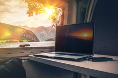 Working While Traveling. Laptop Computer on a Camper Table with Scenic Fjords View. Computer Working in the RV While Camping Stock Images