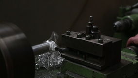 Working on a turning lathe. Mechanic working on a turning lathe, close-up view of hands stock video