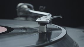 Working turntable player with black vinyl record. Pressing play and turning on the turntable player with black vinyl record stock video footage