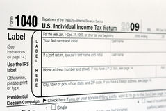 Working on the United States Income Tax 1040. Isolated on white background Royalty Free Stock Image
