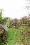 Working in the vegetable garden. Senior man working in the vegetable garden Royalty Free Stock Photography