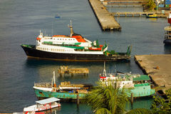 Working vessels at the grenadines wharf Royalty Free Stock Photos