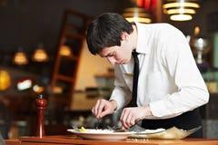Working waiter in uniform at restaurant Stock Photos