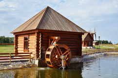 Working water mill in russian village Royalty Free Stock Image