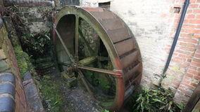 Working Water Wheel. Renovated water mill used to turn a mill stone stock video