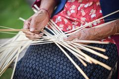 Working weave bamboo Asia Lifestyle countryside. Grandmother senior asian woman working weave bamboo Asia Lifestyle countryside Royalty Free Stock Photo