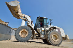 Working with wheel dozer at concrete plant Royalty Free Stock Photo