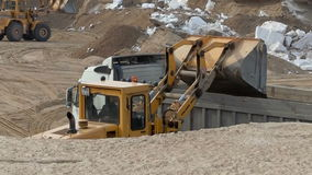 Working wheel loader loads sand in container. View of working wheel loader loads sand in container stock video