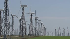 Working wind turbines against a blue sky stock video footage