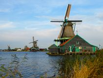 Working windmills at Zaanse Schans near Amsterdam, Holland. Are a popular tourist destination in the Netherlands Stock Image